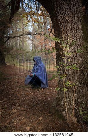 Druid woman in forest to celebrate the sabbat of Mabon