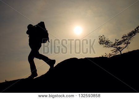 Tourist With Sporty Backpack And Poles In Hands Stand On Cliff And Watching Into Deep Misty Valley B