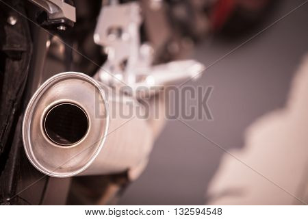Color image of a motorcycle exhaust pipe.