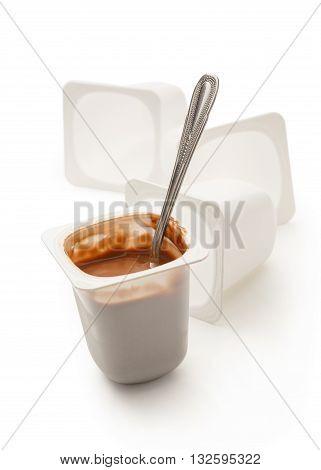 Open Yogurt In Pot With Metal Spoon