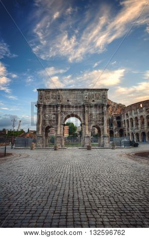 Colosseum and Arch of Constantine at Sunrise with Blue Sky, Rome, Italy