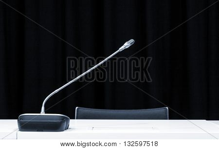 Microphone in press conference room. Monochrome indoors picture