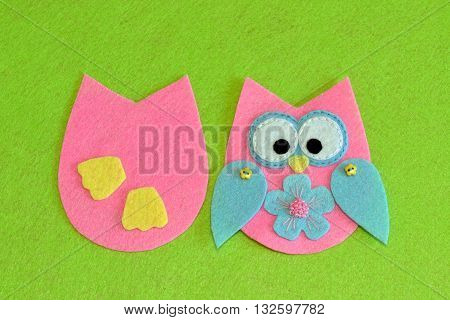 Owl sewing pattern. Stitched details of bird toy. Felt owl ornament tutorial. Decorative cute owl. Idea for arts with scraps of fabric for children. Simple sewing for preschoolers. Green background.