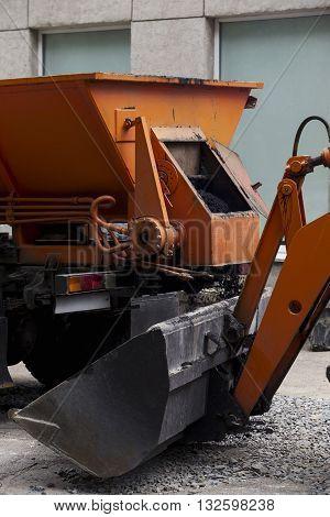 asphalt is loaded into the bucket excavator