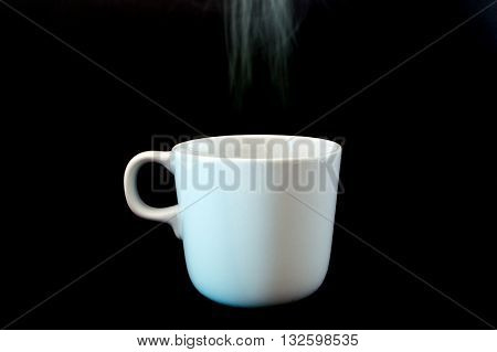 Coffee Cup White With Smoke, Black Background.(selective Focus Fo Cup)