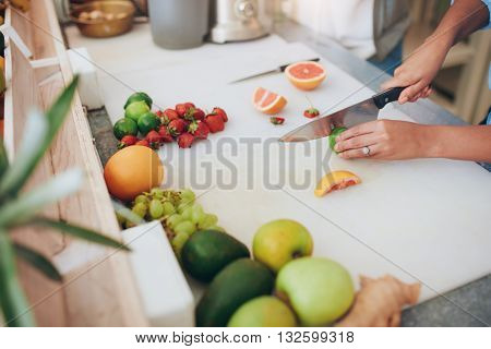 Woman Cutting Fruits At Juice Bar Counter