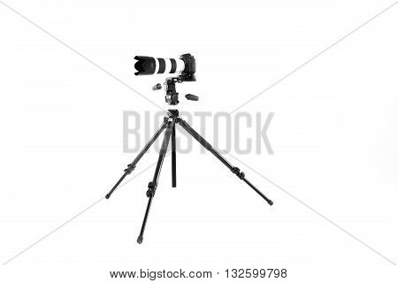 modern professional camera on tripod on white background