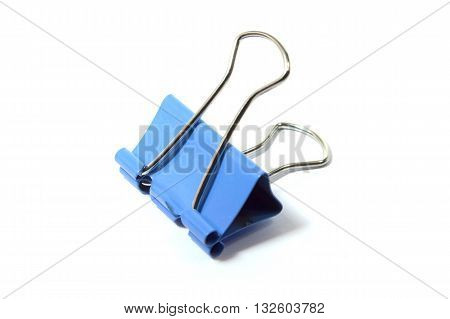 Blue binder clip paperclip on white background.