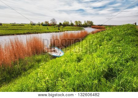 Typical Dutch landscape with water reeds clouds