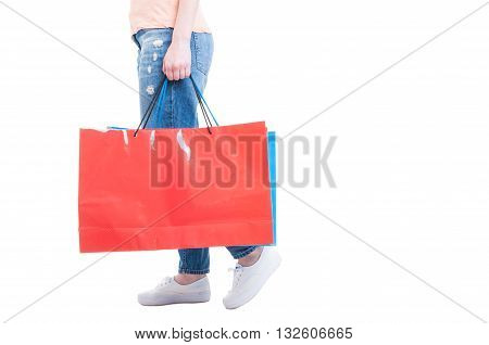 Side View Of Woman Walking And Carrying Big Shopping Bags