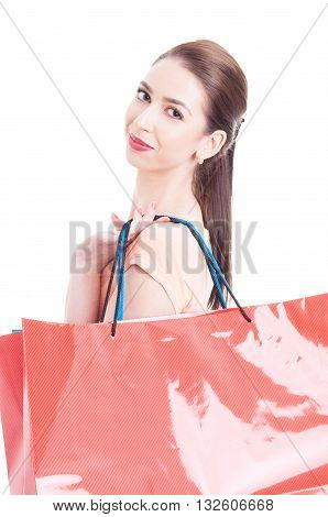 Portrait Of Female Model Carrying Shopping Bags On Shoulder