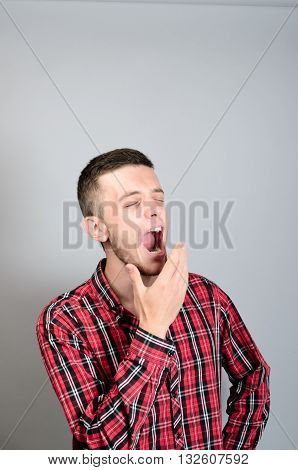 Young Man Yawning