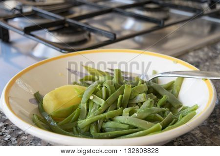 steamed fresh string beans and boiled potatoes