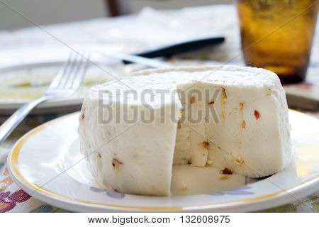 primo sale cheese made with shhep milk and flavored with hot pepper and aromatic herbs