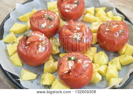 ripe tomatoes stuffed with rice and served with baked potatoes