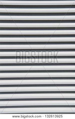 Empty wooden clapboard background textured siding painted in white color with horizontal lines and nobody