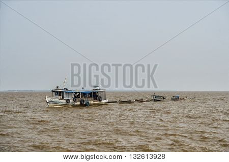 Tugboat On Dirty Water
