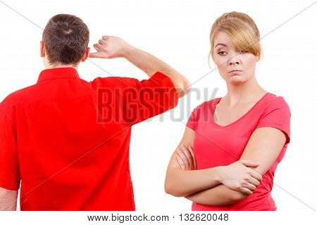 Couple having argument conflict bad relationships. Angry offended woman and man standing with fingers in his ears not listening