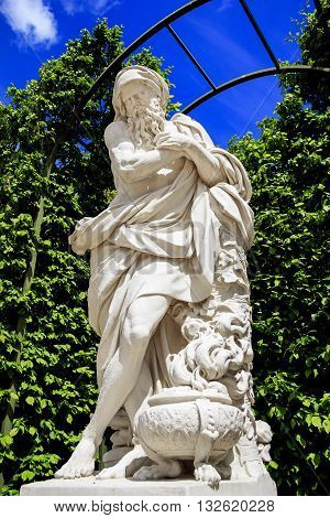 VERSAILLES, FRANCE - MAY 12, 2013: This is one of many sculptures in the antique style located in the gardens of Versailles.