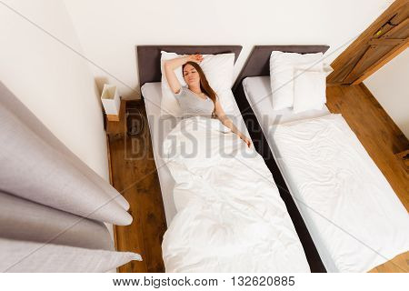 Sleepy Woman Sleeping In The Bed.