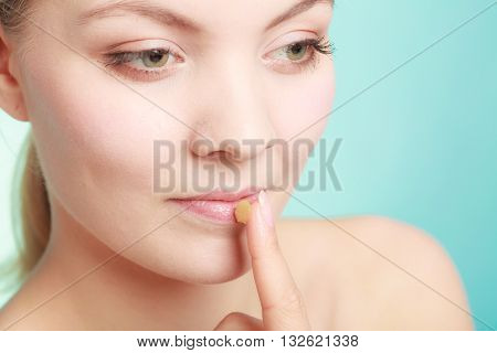 Woman Applying Balsam For Lips