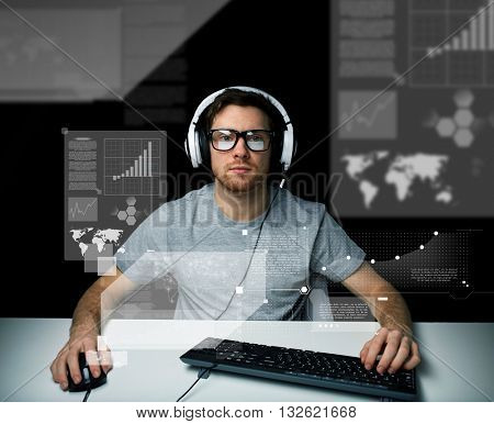 technology, cyberspace, virtual reality and people concept - hacker man in headset and eyeglasses with pc computer keyboard over virtual screens