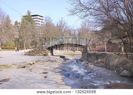 Delicate bridge across the mountain river Olkhovka in city Kislovodsk