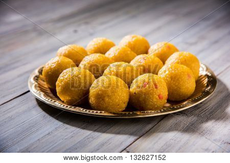 indian sweets bundi laddu or motichur laddu served in , selective focus