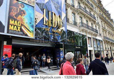 Paris France - May 14 2015: Tourists on the Avenue des Champs-elysees on May 14 2015.The Avenue is one of the most famous streets in the world for upscale shopping.
