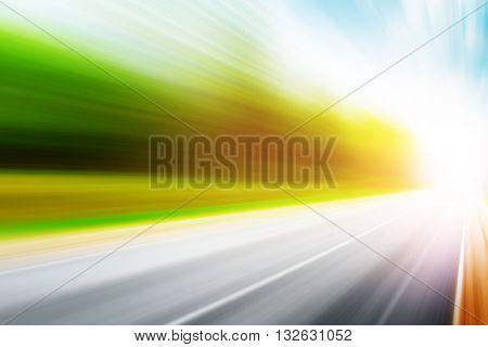 Asphalt road in motion blur at sunset.