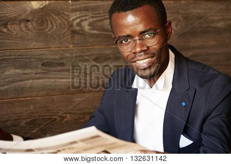 Isolated Headshot Of Happy Successful African American Entrepreneur In Spectacles And Suit Looking A