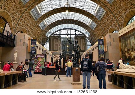 Paris France - May 14 2015: Visitors in the Musee d'Orsay in Paris France. on May 14 2015 The museum houses the largest collection of impressionist and post-impressionist masterpieces in the world.