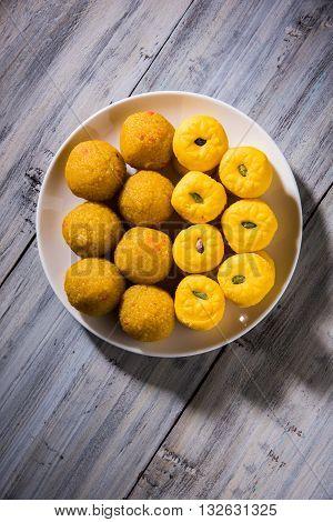 indian sweets bundi laddu or motichur laddu and kesar pedha or pera