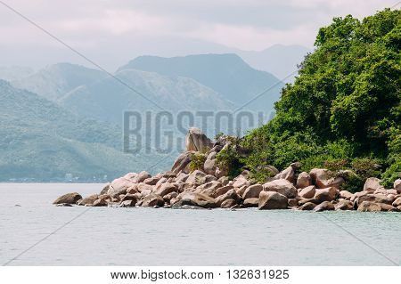 rocky island in Asia, the mountains in the mist