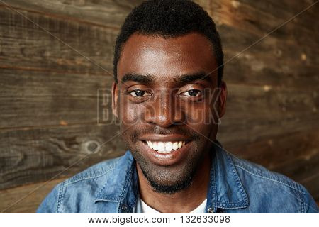 Isolated Headshot Of Happy Young African Man Wearing Stylish Clothes Looking And Smiling At The Came