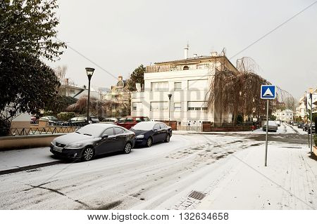 STRASBOURG FRANCE - JAN 20 2016: Winter in the city of Strasbourg Alsace france with cars and houses covered with snow