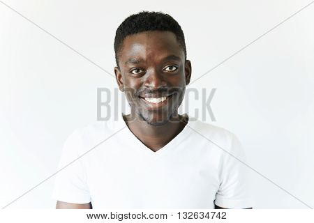 Portrait Of Handsome Young African Black Male Wearing White T-shirt Looking And Smiling At The Camer