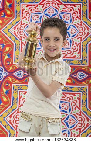 Happy Muslim Young Boy Celebrating Ramadan With Lantern