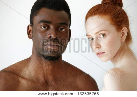 Close Up Shot Of Black Male And White Female Posing Isolated Against White Studio Wall Background. M