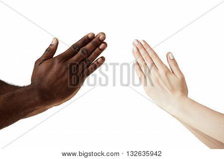 Two People Of Different Races And Ethnicities Holding Hands In Namaste, Greeting Each Other Against