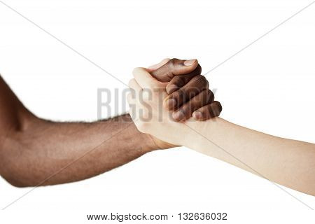 Multiracial Handshake Between Black African Man And White Caucasian Woman. Two People Holding Hands