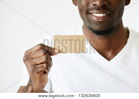 Cropped Shot Of African Male Hands Holding Blank Card With Copy Space For Your Text Or Advertising C