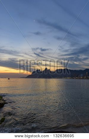 Arpoador Ipanema and Leblon in Rio de Janeiro after sunset with the hill two brothers and Gavea stone at the bottom
