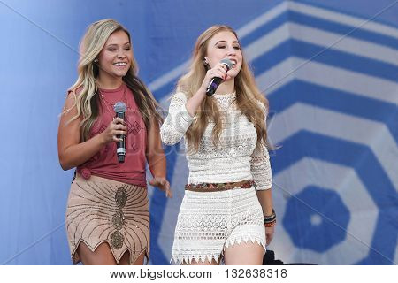 NEW YORK-JUNE 26: Singers Taylor Dye (L) and Madison Marlow of Maddie and Tae perform onstage at ABC's Good Morning America Summer Concert Series at Rumsey Playfield on June 26, 2015 in New York City.