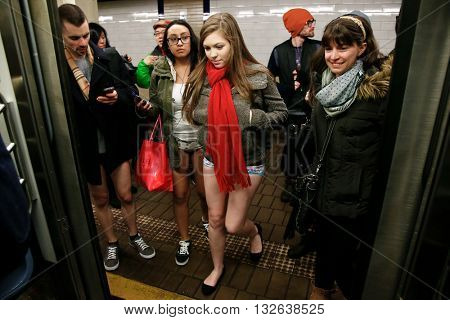 NEW YORK-JAN 12: Participants in the 13th annual international 'No Pants Subway Ride' get on the uptown 6 train on January 12, 2014 in New York City.