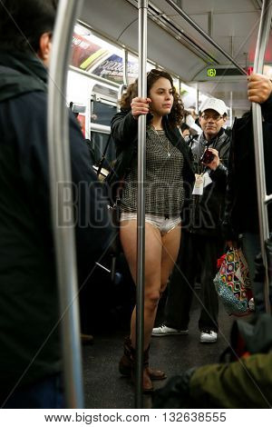 NEW YORK-JAN 12: Participants in the 13th annual international 'No Pants Subway Ride' ride the uptown 6 train on January 12, 2014 in New York City.
