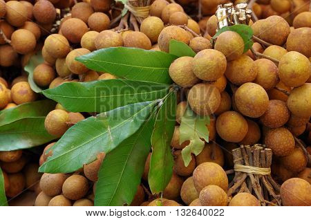 Longan berries fruit bunches in market place