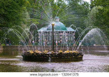 SAINT PETERSBURG, RUSSIA -JUNE 02, 2016: Fountain « The Sun» in Peterhof, near Saint Petersburg. Fountains of Peterhof are one of Russia's most famous tourist attractions