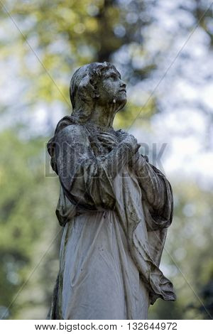 Old cemetery angel sculpture made of stone in Lviv.