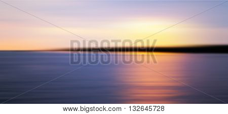 Colorful Sunset Over Sea Coast. Blurred Photo